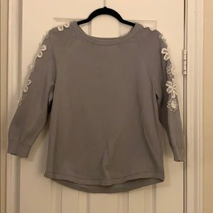 Grey sweater with white flower detail